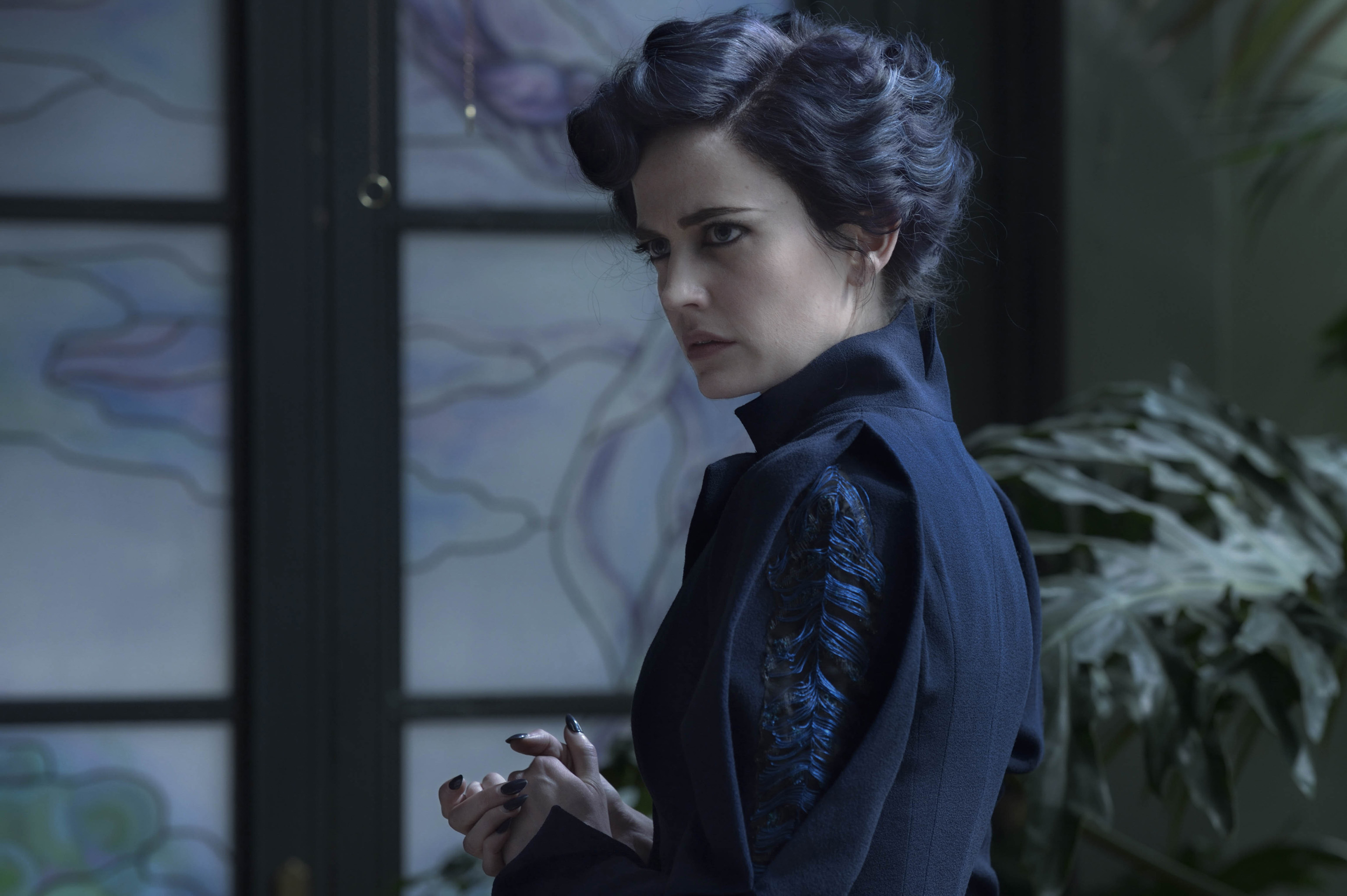 Eva Green portrays Miss Peregrine, who oversees a magical place that is threatened by powerful enemies. Photo Credit: Jay Maidment.