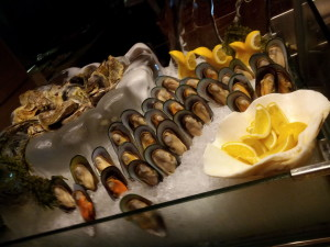The mussels are waving at the seafood station