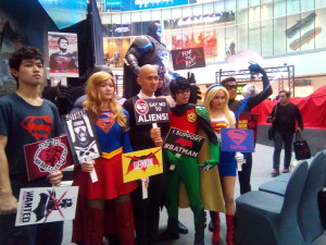 and all the superheroes and villains demonstrate a rally